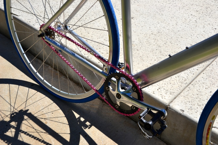 Pink chain, blue tires